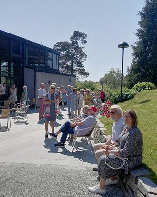 people gather outside Troldsalen