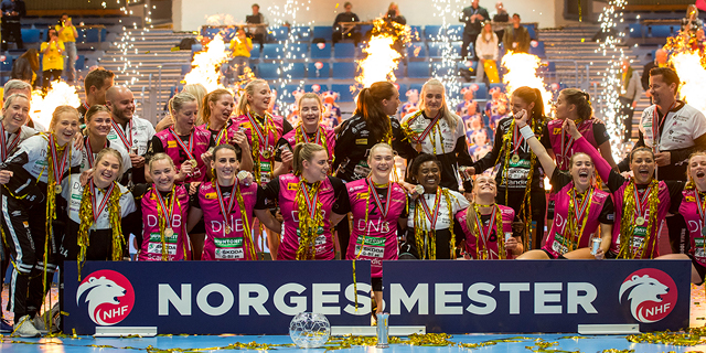 """Kristiansand team poses for a celebratory picture behind a """"Norgesmester"""" sign"""