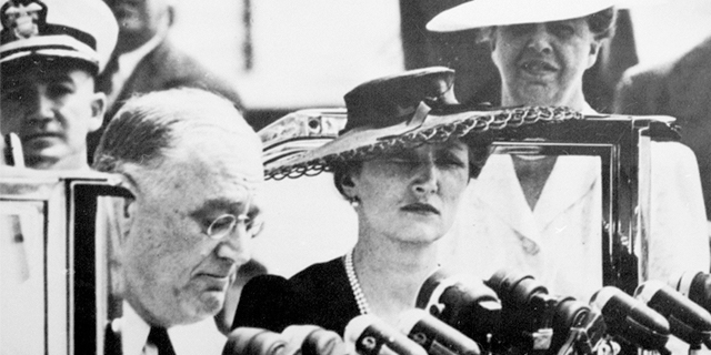 """FDR and Crown Princess Märtha sitting in front of a line of microphones during FDR's """"Look to Norway"""" speech in 1941"""