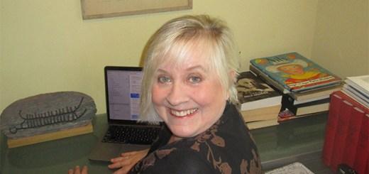Lori Ann Reinhall at her desk