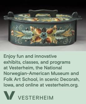 a box that is rosemaled for Vesterheim's ad for their Folk School