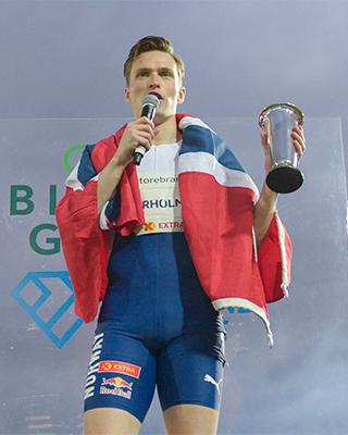 Karsten Warholm speaks to the crowd after winning his race