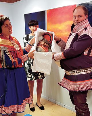 As part of Bååstede a ládjogahpir or horn hat is handed over from museum director to the Sámi Parliament President