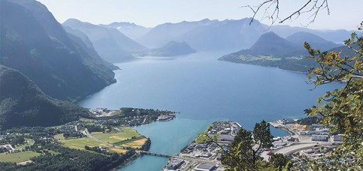 view of a fjord from the peak of a mountain by someone hiking