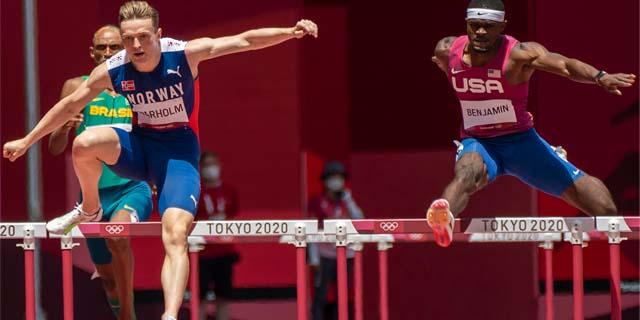 karsten warholm and rai benjamin running the 400m hurdles