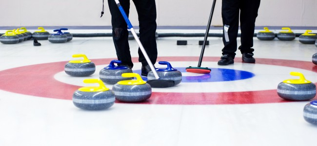 playing the curling sport