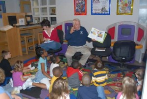 man-reading-to-children