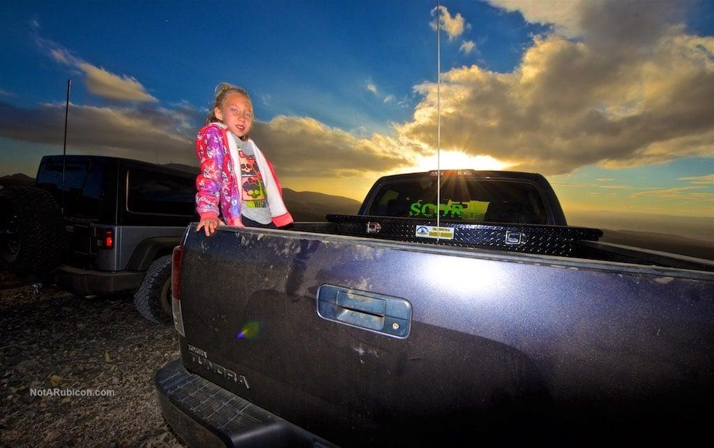 Little girl at sunset on a SCOR truck