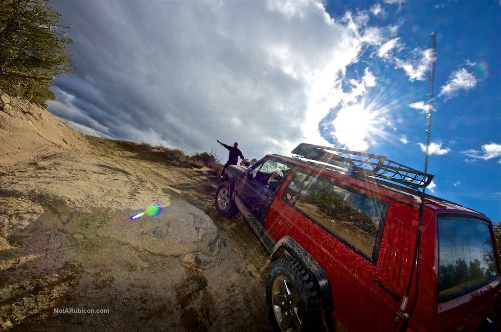 Jeep Cherokee going up rocks at Cleghorn