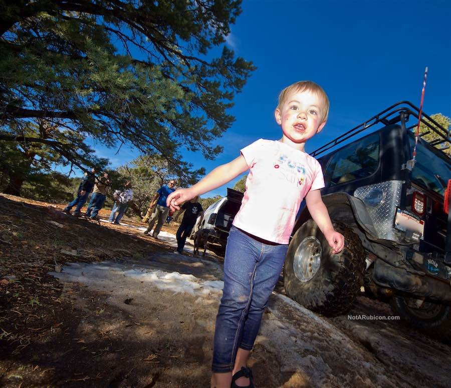 Little girl playing on the Gold Mountain off-road trail