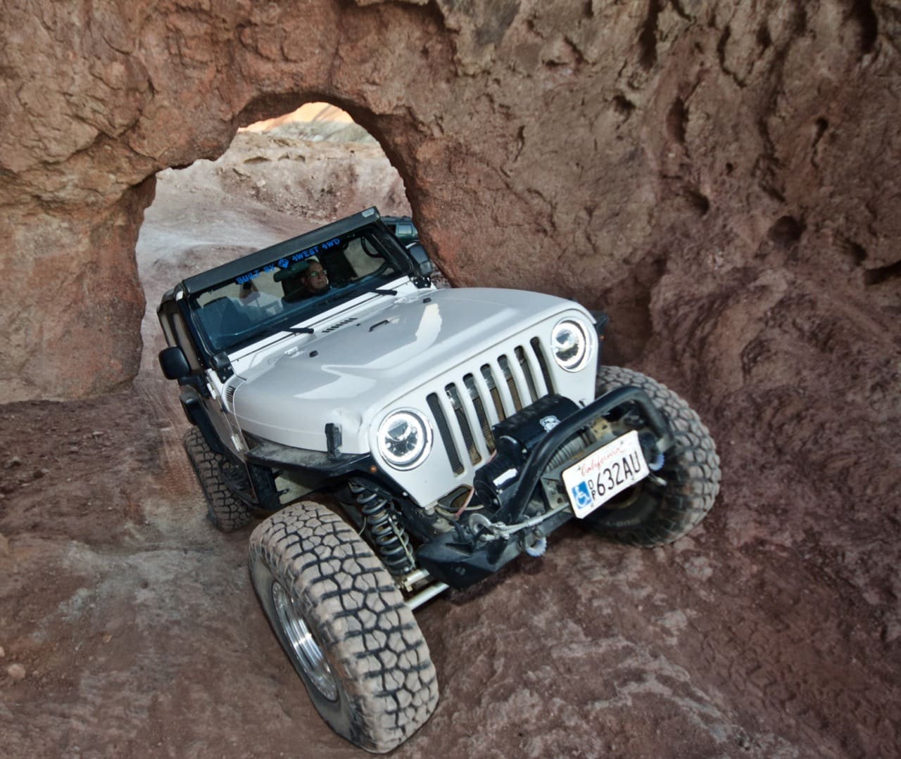Jeep TJ coming through Kramer's Arch, near Calico Ghost Town