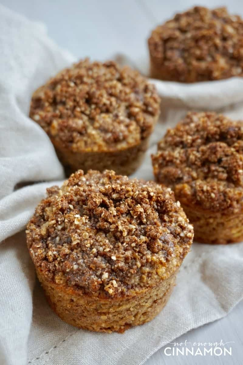 Gluten Free Apple Snickerdoodle Muffins, so perfect for Fall baking! They're dairy free and refined sugar free too! Recipe on NotEnoughCinnamon.com #cleaneating #healthy