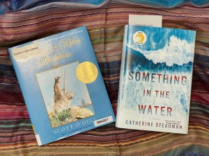 two books: The Island of the Blue Dolphins and Something in the Water