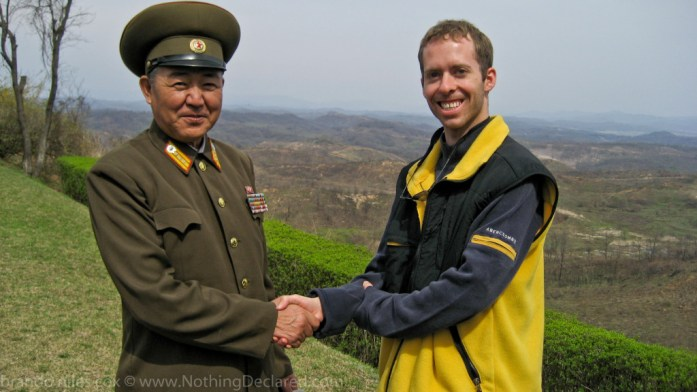 Standing on a hill in North Korea overlooking the South, chatting with a North Korean General