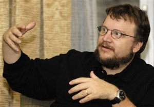 """** FILE ** In this Dec. 11, 2006 file photo, Film director Guillermo del Toro gestures during an interview in Washington. Del Toro is directing """"The Hobbit"""" and its sequel. New Line Cinema announced Thursday that the 43-year-old filmmaker will move to New Zealand for four years to work with executive producer Peter Jackson and his production teams. (AP Photo/Nick Wass)"""