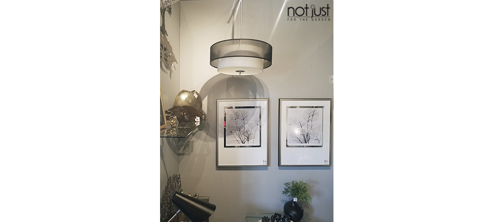 Canadian made pendant/ceiling light with a white linen shade and second dark grey organza shade over top, with a pewter rod, hung in front of wall art