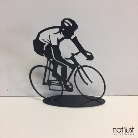 Black metal tabletop sculptural art of man riding a bicycle