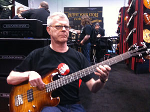 Will Marks trying out a bass at DBZ Guitars
