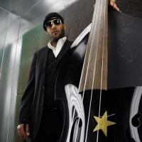 Miles Mosley with bass