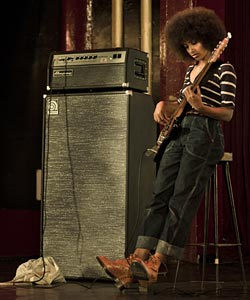 Esperanza Spalding playing electric bass