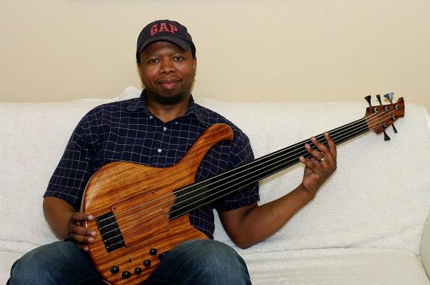 Vuyani Wakaba with his HJC Customs Alchemy Fretless 5 Bass