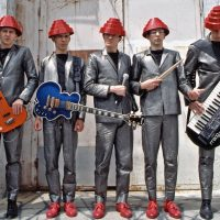"Eastwood Guitars Recreates Devo ""Be Stiff"" Bass Guitar"