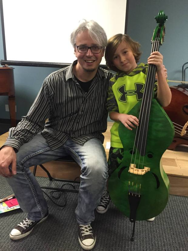 Claus Freudenstein with Minibass and child