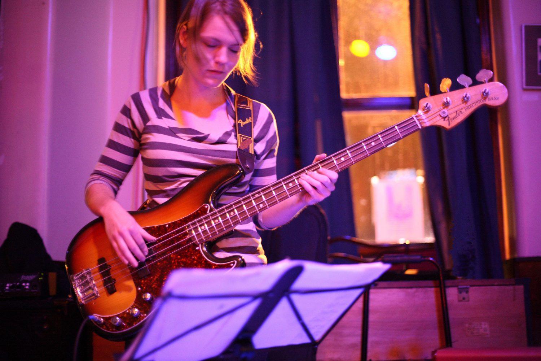 Bassist reading music