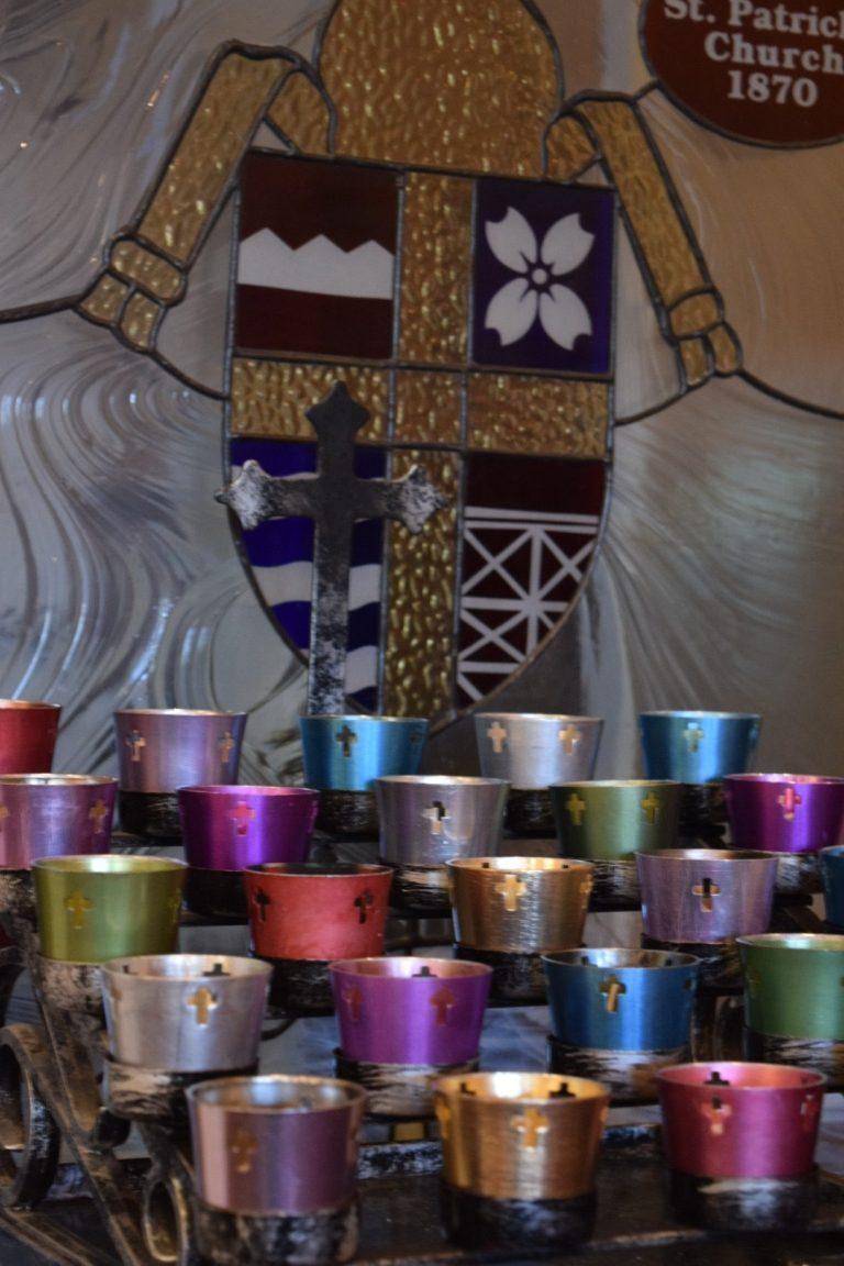 colored tin prayer candles