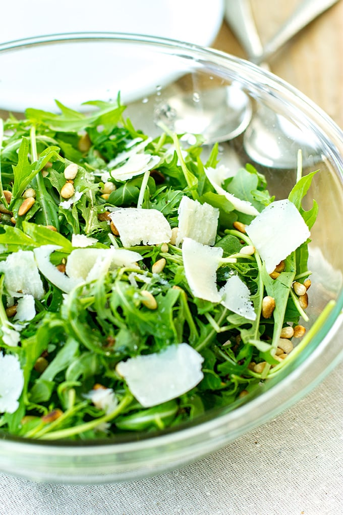 This arugula parmesan pine nut salad is ready in just 5 minutes. A quick, easy, fresh side for any weeknight meal!