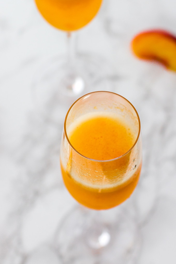 Classic peach bellini | The essential sparkling cocktail with champagne or prosecco and lightly-sweetened peach puree.