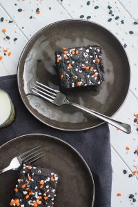 Two slices of spooky blackout chocolate buttermilk cake.