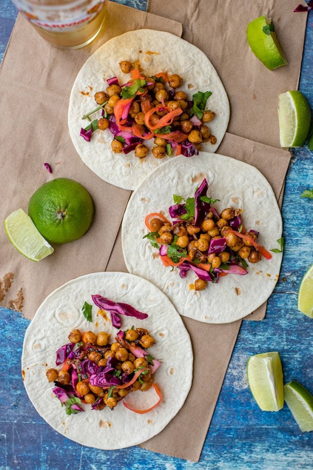Three crispy chickpea tacos lined up and ready to devour.