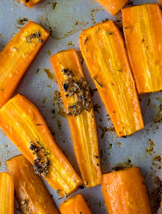 Thyme roasted carrots fresh from the oven, slightly browned, crinkly, and fork-tender.