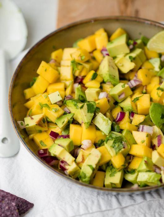 A large bowl full of fresh mango avocado salsa.