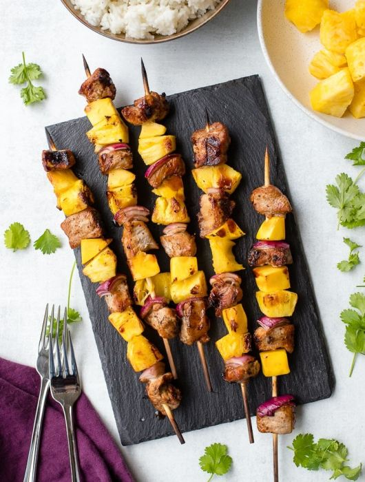 Pork pineapple kabobs with mango grilled on bamboo skewers.