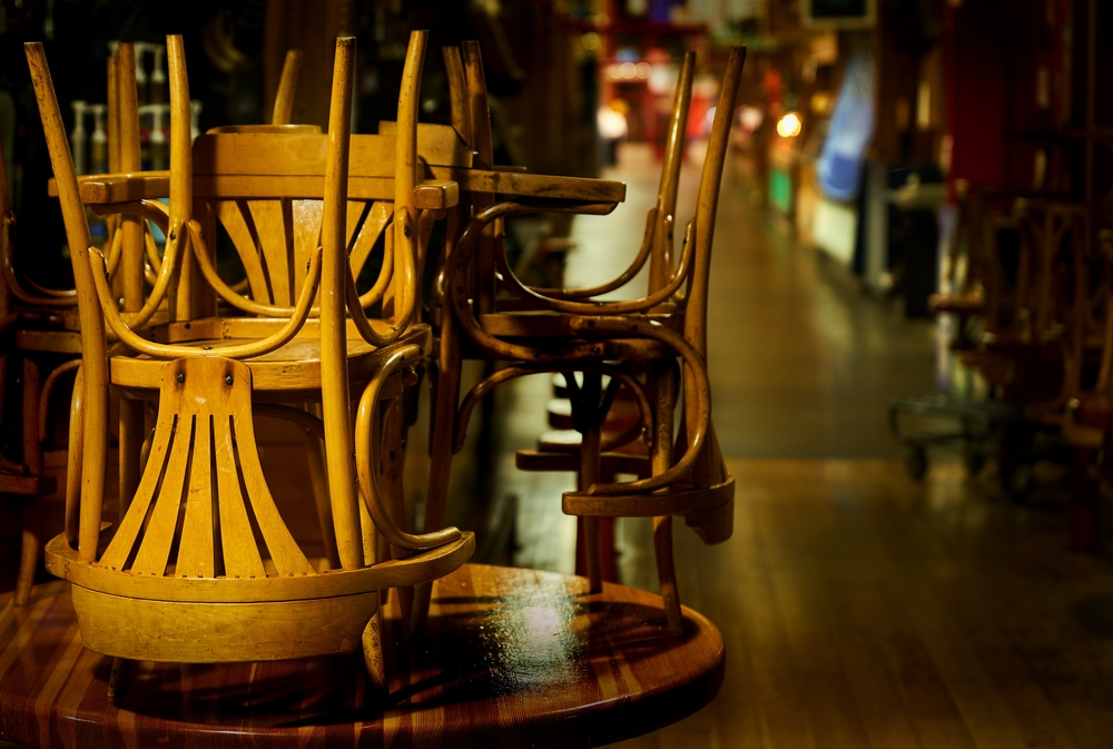 Chairs piled on tables in a restaurant