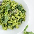 Spinach Pesto Pasta with Basil and Goat Cheese | nourishedtheblog.com | feature image
