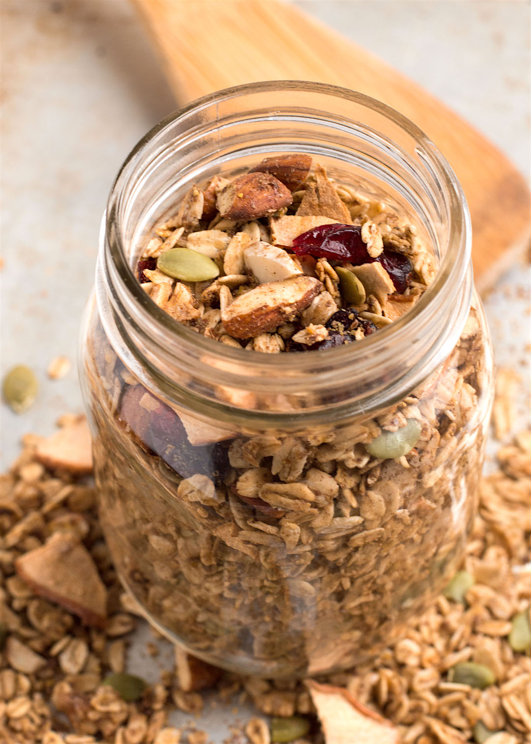 This Apple Cinnamon Granola recipe is a vegan, gluten free and healthy breakfast option made with only real and good-for-you ingredients like oats, nuts, seeds and dried fruit. It's like all the flavours of apple pie coming together in a granola that is pretty much like a healthy dessert for breakfast.