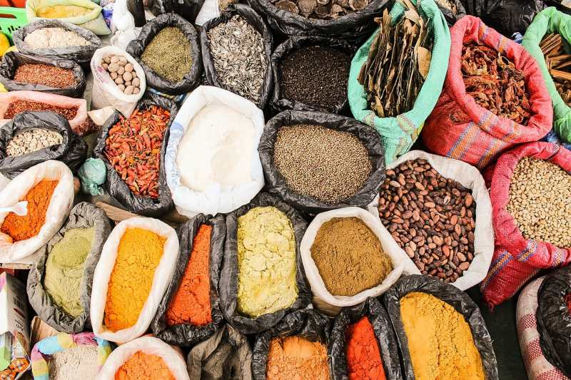 image of multiple spices in colorful bags
