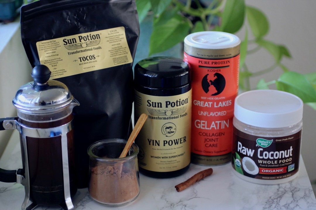 Superfoods to make Nourishing Wild's Famous Superfood Latte - raw cacao, Sun Potions Yin and Tocos, gelatin, coconut butter, french press coffee, cinnamon | Nourishingwild.com