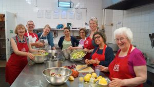 Nourish Scotland team preparing healthy food with a smile
