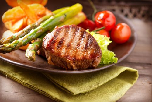 steak with veggies on a plate