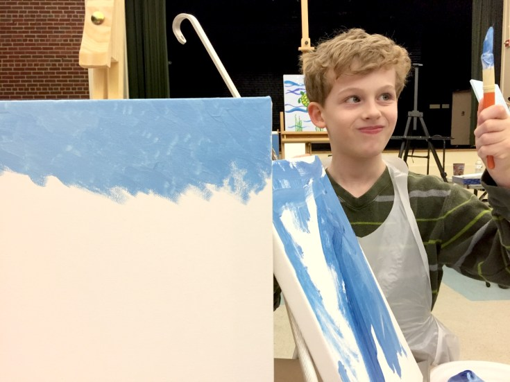 The artist at work Family Paint Night Alexandria VA Joy Troupe NOVA