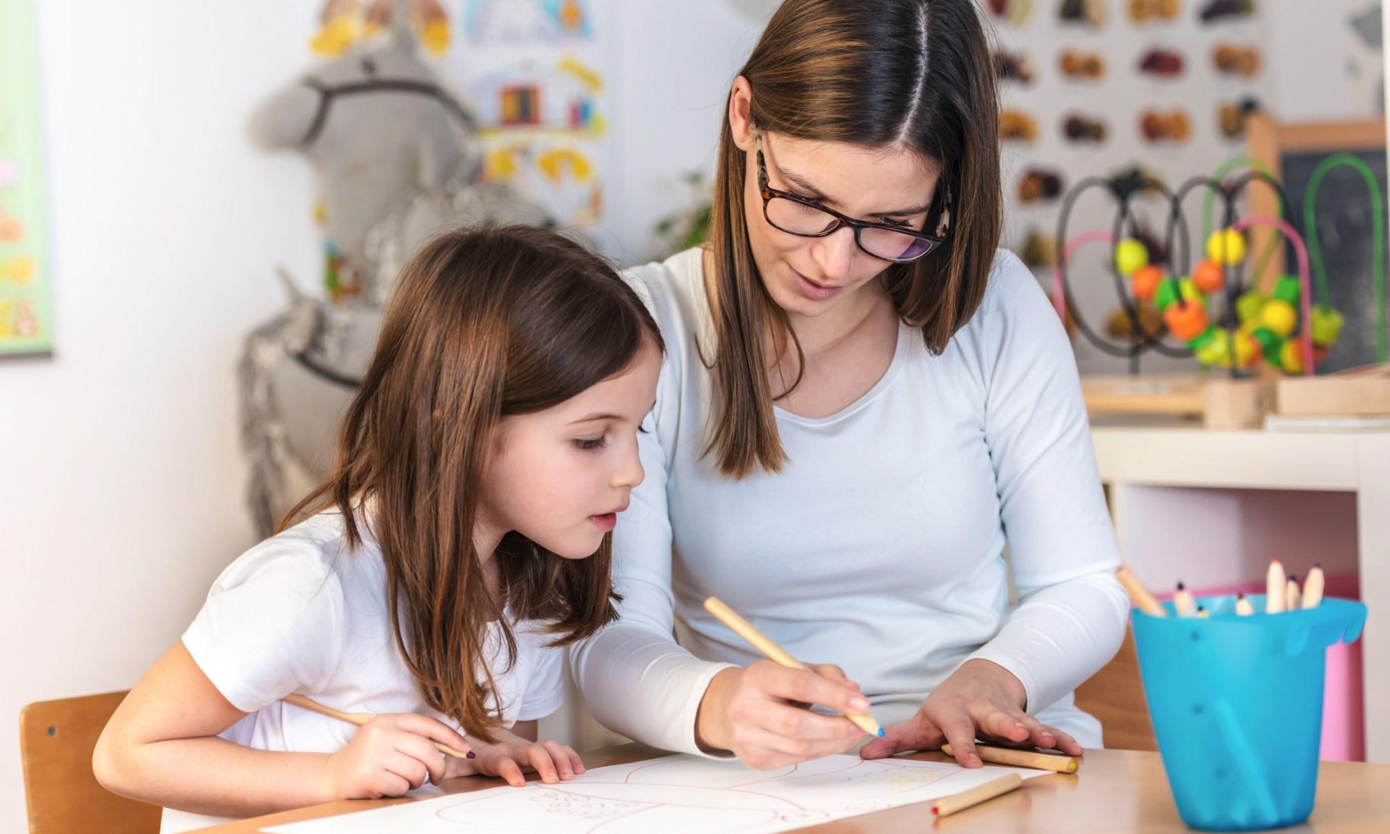 mom teacher working with creative child