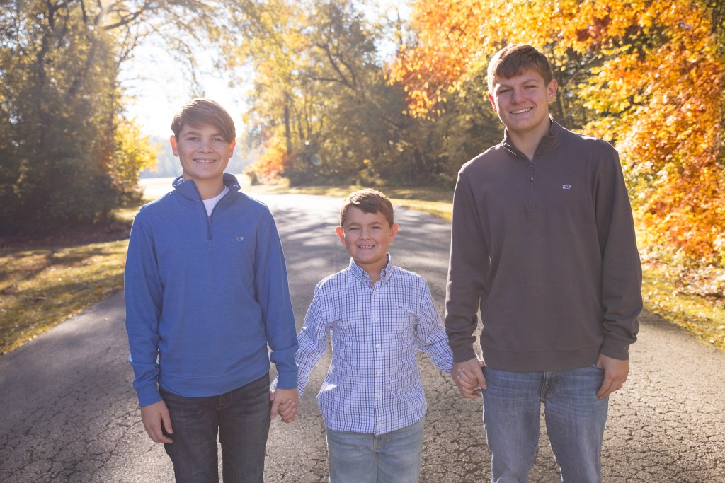 Three brothers holding hands at a Northern Virginia Family photography session.