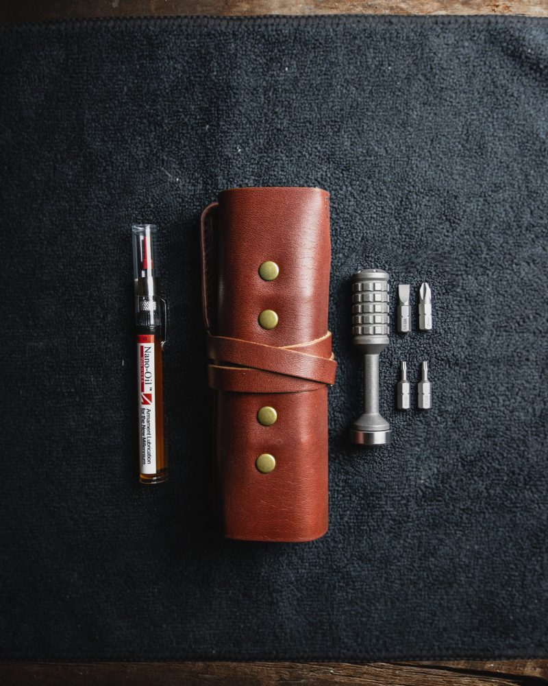 Leather tool roll with titanium bit driver