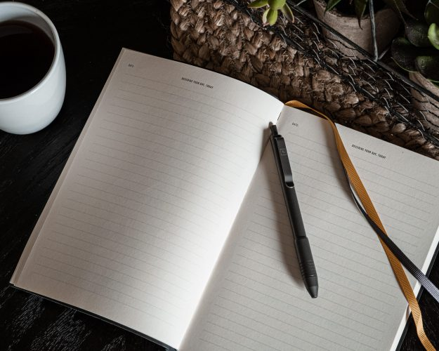 BigIDesign Ti Click EDC Pen on Journal