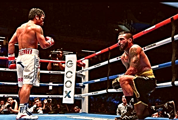Pacquiao KOs Matthysse in 7th, wins back world title