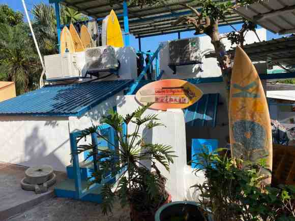 Big Wave Bay village welcomes you with surf boards.